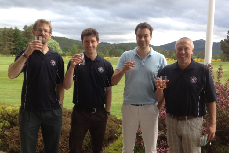 4 golfers at Ballater golf course with drinks in their hands