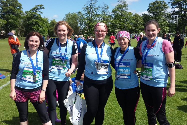 5 people in Euan MacDonald Centre T-shirts smiling at the camera having just finished the marathon