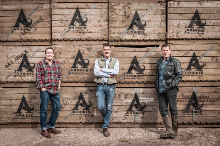 3 men stood in front of Arbikie branded boxes