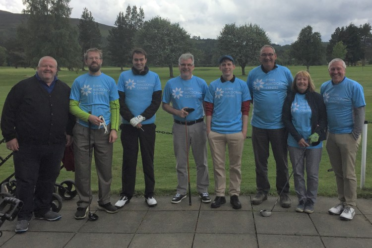 Golfers in Euan MacDonald Centre T-shirts