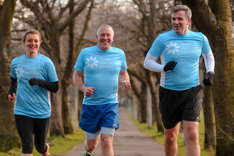 three runners in blue Centre T-shirts