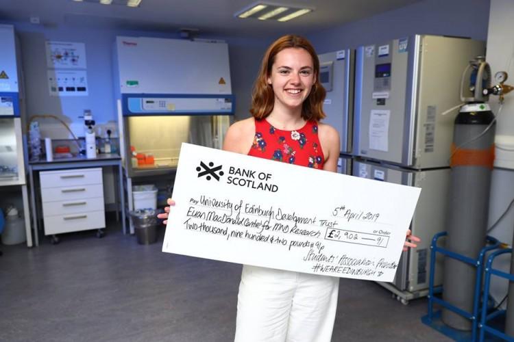 EUSA President Holding a cheque